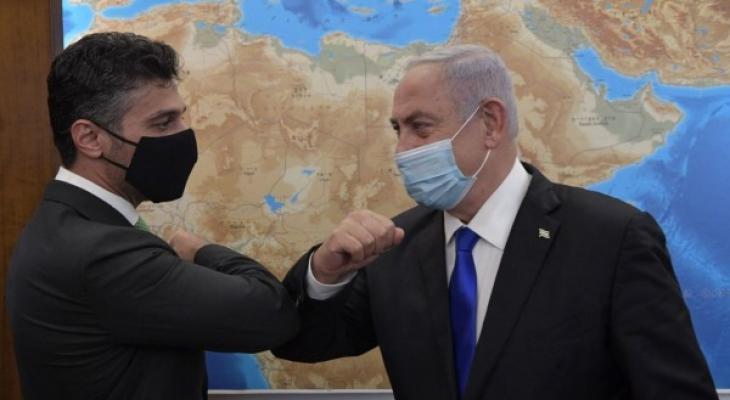 نتنياهو وسفير الامارات.jpg