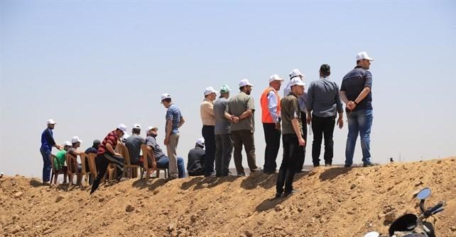 قوات من حماس بلباس برتقالي على حدود غزة1.jpg
